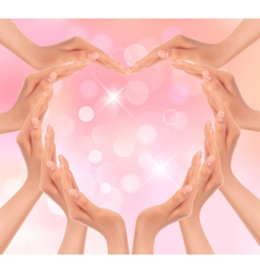 Hands making a heart valentines day background vector