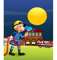A fireman holding a hose vector
