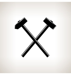 Silhouette of a crossed hammer and sledgehammer vector