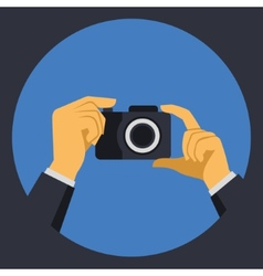 Digital photo camera with hands in flat retro vector