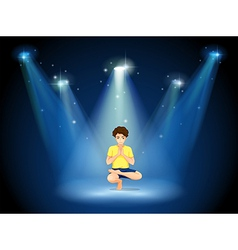 A boy doing yoga at the stage vector
