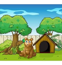 A bear sitting inside the fence vector