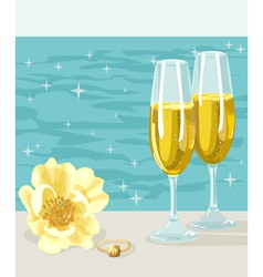 Two glasses of cold champagne flower and ring vector