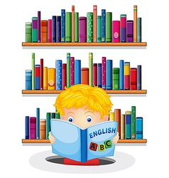 A boy in the library reading an english book vector