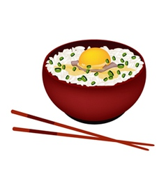 Bowl of white rice with raw egg and scallion vector