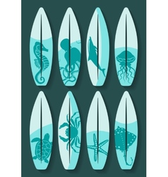 Surfboards set with blue sea creatures drawing vector