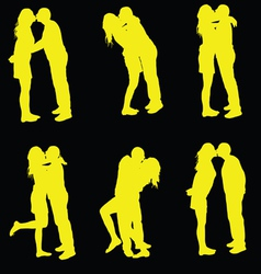 Couple kissing yellow silhouette vector
