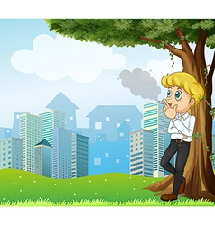 A boy smoking under the tree across the buildings vector