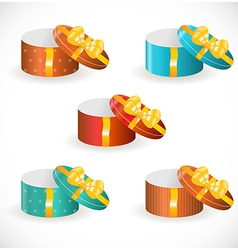 Gift boxes with gold ribbons vector
