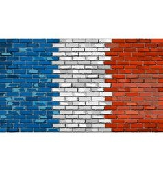 Grunge flag of france on a brick wall vector