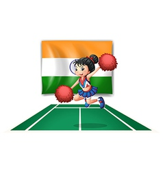 A cheerleader in front of the indian flag vector