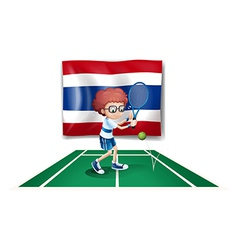 A boy playing tennis in front of the thailand flag vector