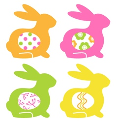 Easter bunnies with eggs isolated on white vector