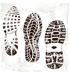 A high detailed set of three grunged shoe tracks vector