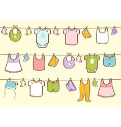 Cute hand drawn baby clothes vector