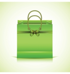 Green paper shopping bag vector