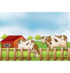 A farm with two cows inside the fence vector