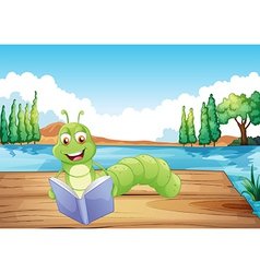 A worm reading a book vector