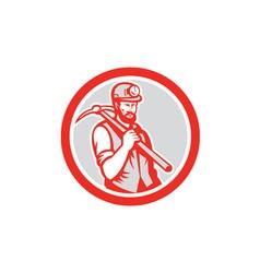 Coal miner hardhat holding pick axe circle woodcut vector