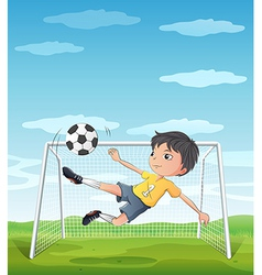 A young athlete kicking the soccer ball vector