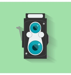 Flat vintage camera icon isolated on green vector