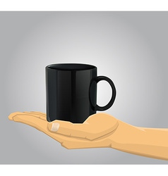 Hand holding a cup vector