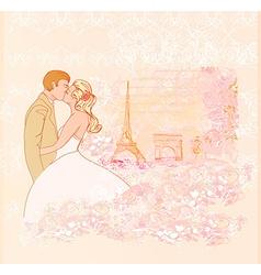 Romantic wedding couple in paris kissing near the vector