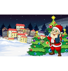 Santa claus standing beside the christmas trees vector
