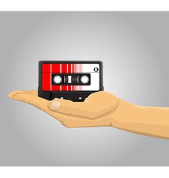 Hand holding an audio casette vector
