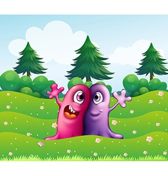 Two adorable one-eyed monsters near the pine trees vector
