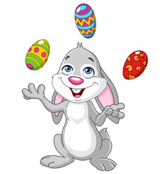 Bunny juggling easter eggs vector
