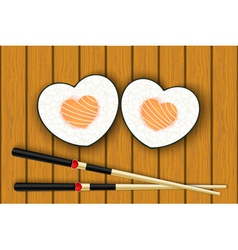Heart-shaped sushi and chopsticks vector
