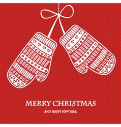 Christmas mittens on red knitted background vector