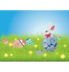 Easter bunny and grass field vector