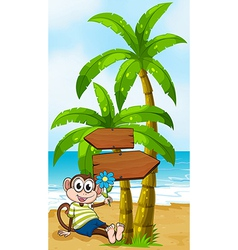 A beach with a smiling monkey sitting under the vector