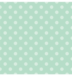Seamless pattern with light green polka dots vector