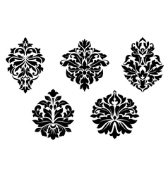 Floral and foliate damask design elements vector