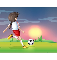 A girl playing football in the afternoon vector