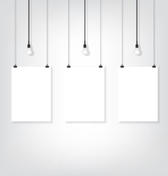 Three white poster on wall and bulb vector