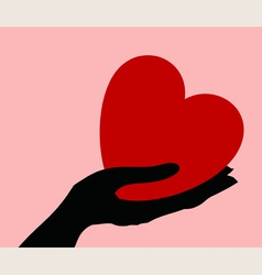 Heart in a hand vector