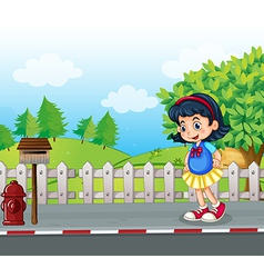 A pupil at the street near the mailbox vector