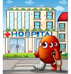 A multi-eyed monster in front of the hospital vector