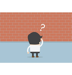 Businessman standing in front of a large brick wal vector