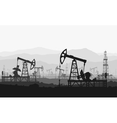 Oil pumps at large oilfield over mountain range vector