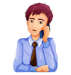 A handsome businessman using a cellphone vector