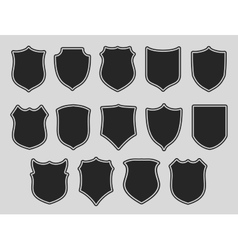 Set of shields over grey background vector