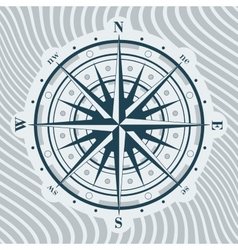 Compass rose over background with waves vector