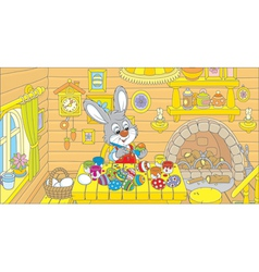 Little bunny paints easter eggs vector