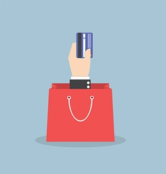 Businessman hand holding credit card with shopping vector