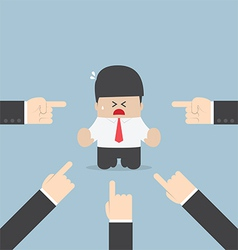 Businessman being pointed by a lot of hands vector